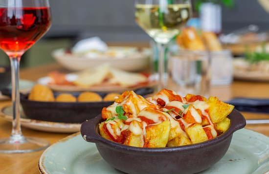 The famous Spanish patatas bravas. Homestyle fried  potatoes, with a spicy tomato sauce.