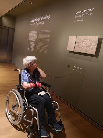 Van Gogh Museum Ticket in Amsterdam: My Mom, listening to one of the audio exhibits