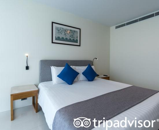 The One Bedroom Family Suite with Balcony at the Splash Beach Resort by Langham Hospitality...
