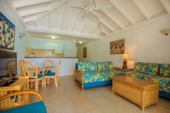 Shoal Bay Villas: One Bedroom Deluxe Oceanfront. These units can accommodate up to four persons. Living room has two twin sized say beds. Fully air-conditioned and located right on the beach.