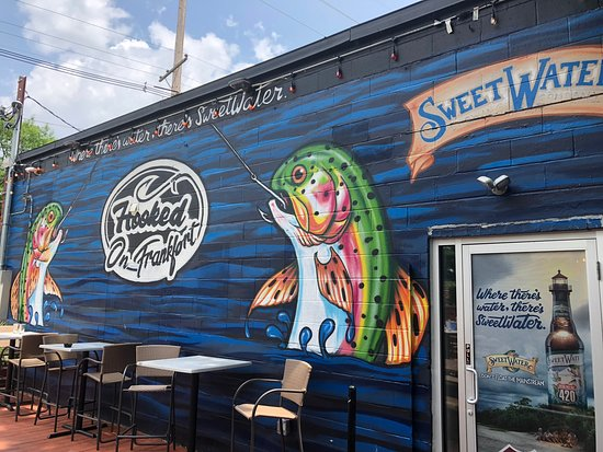 Cool wall mural by the outdoor patio - Picture of Hooked on Frankfort mural - louisvilles best seafood
