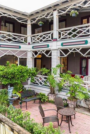 The Old Powder House Inn: Garden, porch, and veranda