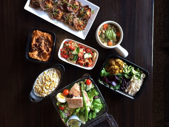Top - clockwise: buffalo chicken cups (catering only), maple pecan sweet potatoes, creamed corn, antipasto salad, salmon nicoise salad, buddha bowl, minestrone with pesto