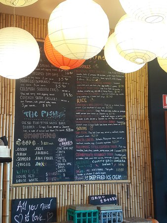 Menu displayed on a large board next to bar (printed is also available)
