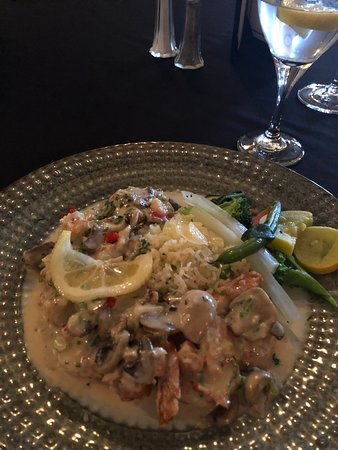 Prosciutto wrapped Tiger Shrimp with Snow Crab Cream Sauce, Green Onion and Mushroom. Served with Confetti Orzo.