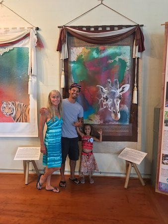 Calley ONeill , Star Wars artist Shane Molino and his daughter in front of their favorite RAMA painting.