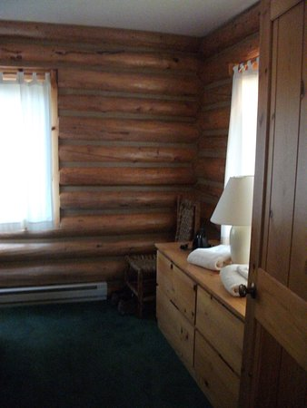 Dornan's Spur Ranch Cabins: dresser and chair in bedroom