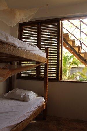 Habitación para cuatro personas con mosquitero