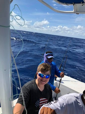 That is one happy kid.  He spent the rest of the trip planning his next fishing adventure and watching YouTube videos on sport fishing. This one is hooked!