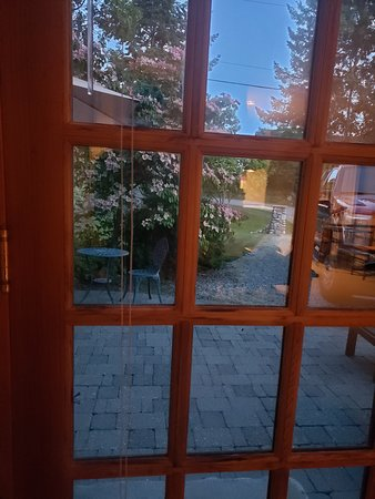 Looking out the door towards the seating area and the yard. Sorry about the reflection,