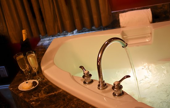 Luxury guest rooms feature a bubbling tub for two!