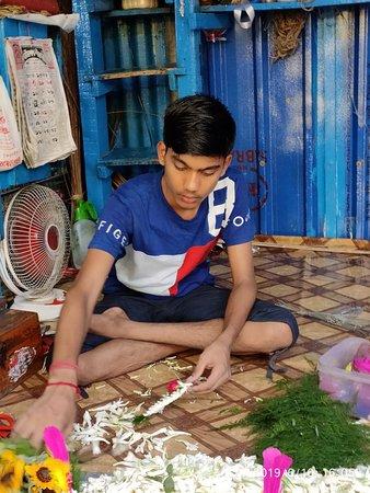 Preparing flower for bride and groom