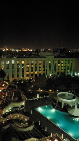 Night view of the pool area and city skyline