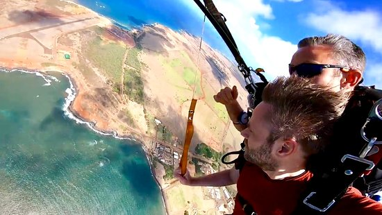 Hudson letting my boyfriend steer the parachute, beautiful view!