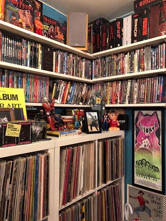 The shelves are full of DVD and Vinyl records, which you can actually play!