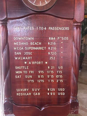 Playa Grande Resort: Some of the transportation rates posted at the front.