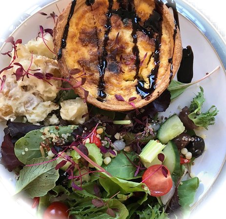 Quiche of the day with the popular house salad and a potato salad.