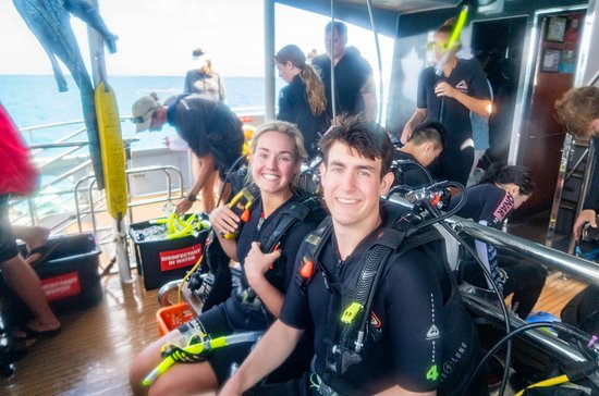 Passions of Paradise Great Barrier Reef Snorkel and Dive Cruise from Cairns by Luxury Catamaran: Right before we jumped in! Staff was super helpful with the scuba gear.