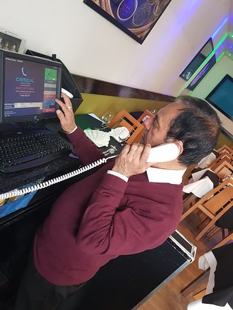 Suraj taking orders over the phone from one of our regulars
