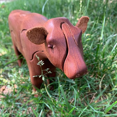 Wooden puzzle cow with milk inside! Made in WV by Peter Chapman.