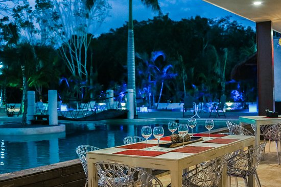 Enjoy a delicious meal by the pool