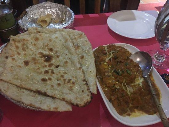 Sher-e-Punjab: garlic naan and chicken masala