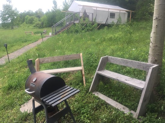 The Meadow @ Shelterbelt Farm: Charcoal BBQ (charcoal provided), and benches just off the deck of the kitchen.