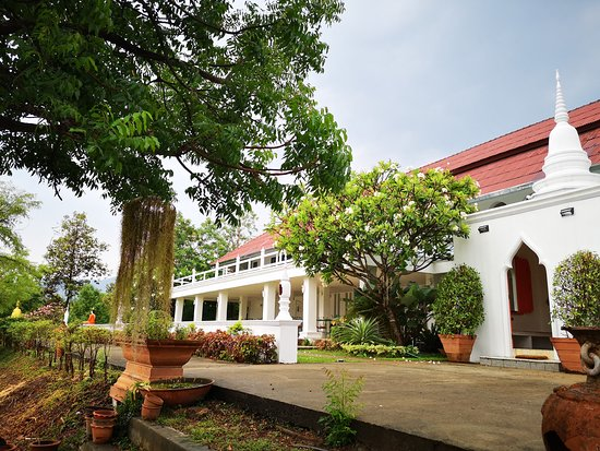 The green area and front gate to our main building