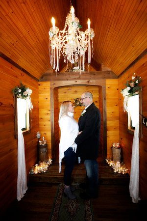 Elope Niagara's Little Log Wedding Chapel: Picture yourself here,under the chandelier! Our Little Log Wedding Chapel is cozy, charming and intimate, open year round