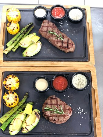 Filet Mignon & New York steak with green asparagus, grilled avocado and corn. It was amazing!!!