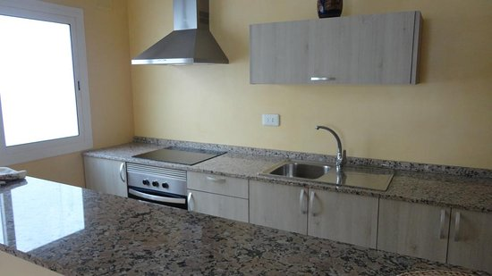 Apartamentos Cala Llonga: BEST PRICE The apartments are conveniently located in front of the beach! We have one and two bedroom apartments. All of them have dinning room, living room, bathroom, balcony and a fully equiped kitchen. Some have AC. The buildings' amenities are: Supermarket Cala Llonga Gift Store Press  Currency Exchange ATM Machine  To make a reservation please send an email to: apartamentoscalallonga@gmail.com, we will give you the steps to make a reservation.