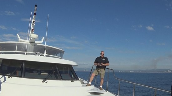Super Yacht Whale Watching: The skipper is counting how long Whales are underwater so we can estimate, when they will come back to the surface.