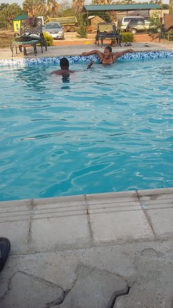 South Luangwa National Park, Zambia: enjoying swimming after eating the braii at ctvlodge in mfuwe