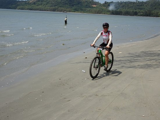 SpiceRoads Cycling: Wilds of Cambodia - riding on the beach