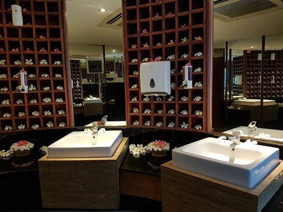 Bathroom with marble vanities and fresh frangipanis