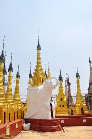 Nearer pagoda has been restored in Gold