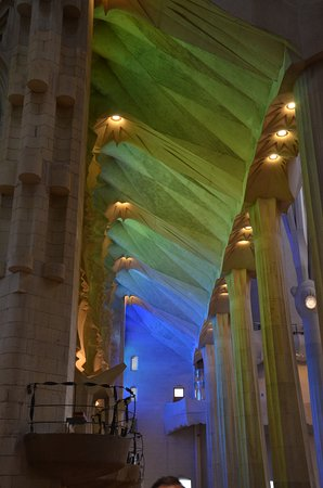 Basilica of the Sagrada Familia Admission Ticket with Tower Access: Interior soft light from the nativity facade