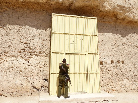 Tell el-Amarna: One of the tomb entrances being unlocked for us to go in.
