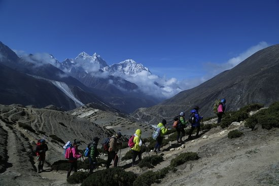 Successful Everest Base Camp 2019 May/June including top of the world (Sarmila with our Traveltimes Treks banner). And our bc trekking group