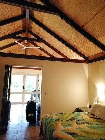 Palm Grove: bedroom with views towards living room and kitchen (other side)