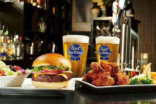 Symposium Cafe Restaurant & Lounge: Burgers, Chicken Wings and Draught Beer Monday special