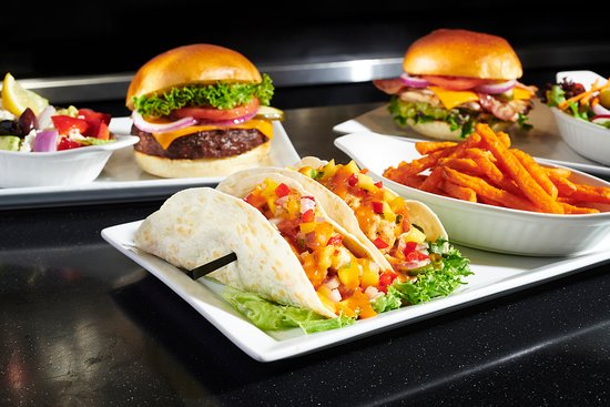 Symposium Cafe Restaurant & Lounge: Burger, California Chicken Sandwich and Fish Tacos