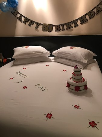 Apsara Beachfront Resort and Villa: The room decorated for a special birthday - the cake is made from towels!