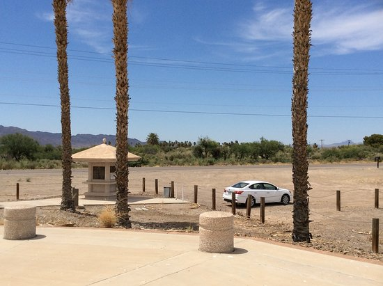 Photo taken from the Poston Memorial looking back to the Highway and parking lot.  The monument grounds are well kept but most of the interpretive plaques on the monument are badly weathered as of 2019.