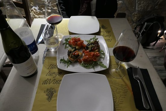 table with wine and Bruschette