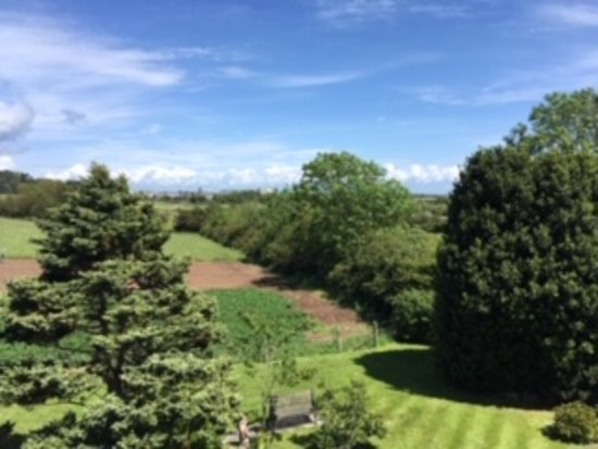 Wychwood House: Towards Tenby showing garden, fields and further on the golf course with public pathway