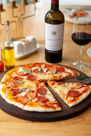 Good company, hand tossed pizza and a bottle of Primitivo Carlomagno