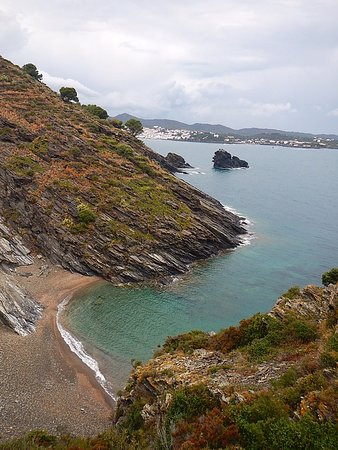 A secluded cove accessible on the hike with Cadaques in the background