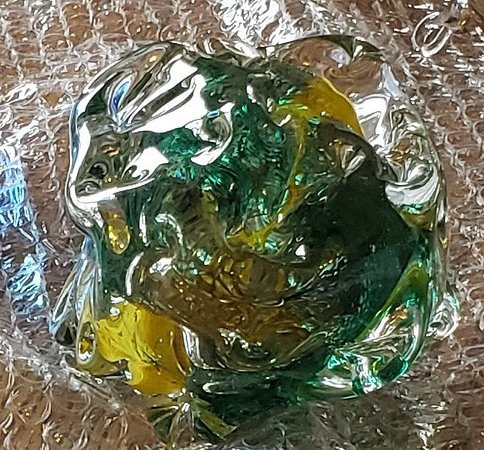 glass blob - lots of facets and bubbles with swirls of emerald green and golden yellow
