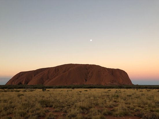 Uluru at sunset with colours behind